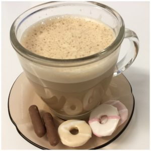 A cup of cafe au lait and mini biscuits